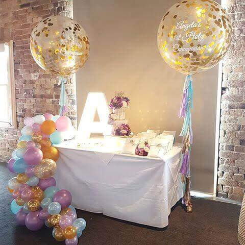 big gold confetti balloons with balloons garland for communion